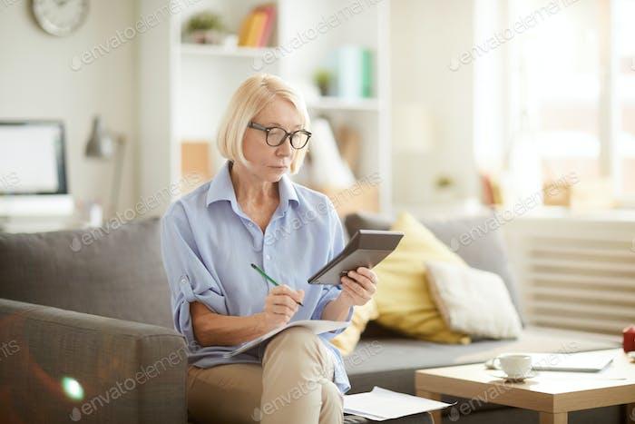 Senior Woman Calculating Budget
