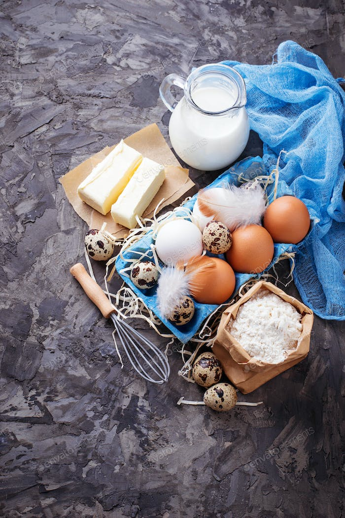 Ingredients for baking Easter cake. Milk, butter, eggs, flour
