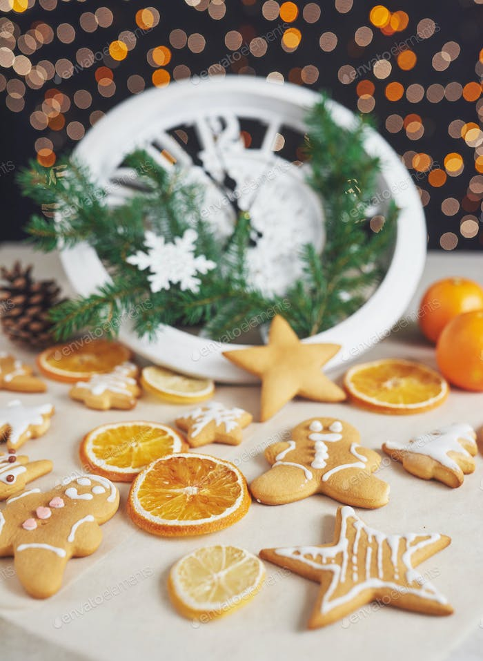 Decorating a spicy cookie with white glaze and orange. Happy New Year.