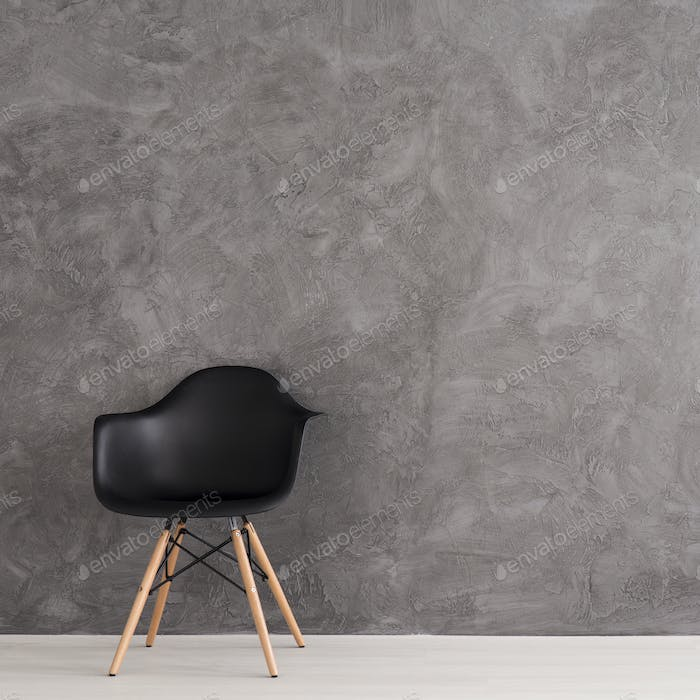 Modern, black chair in grey interior