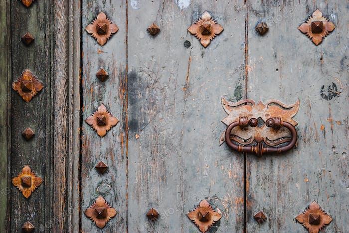 Old wooden door with metal decor background