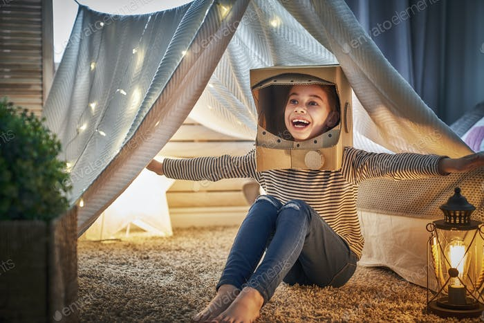 kid playing in tent