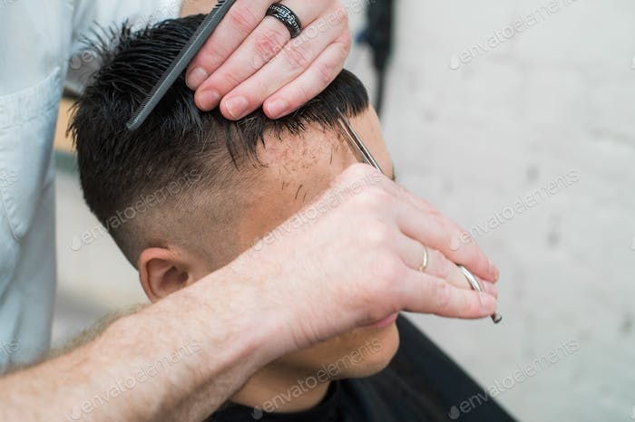 close up shot of man getting his hair cut
