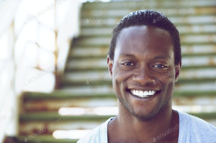 Portrait of an african american man smiling outdoors
