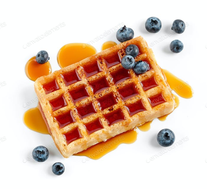 waffle with caramel syrup and blueberries