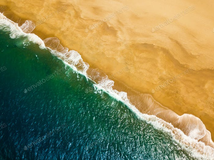 Top view of a deserted beach. The Portuguese coast of the Atlant