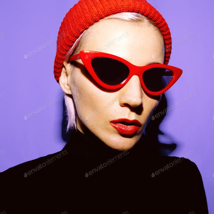 Fashion Girl and trendy Accessories. Red Beanie and Retro sungla