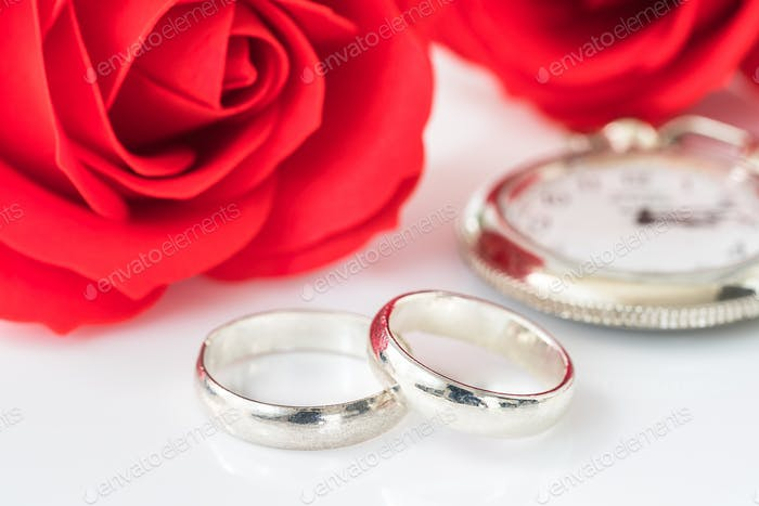 Red rose and wedding ring on white_-3