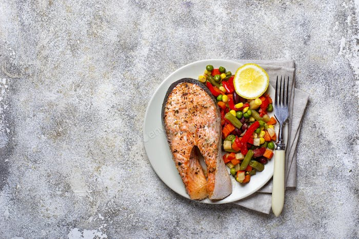 Baked salmon fillet with vegetables