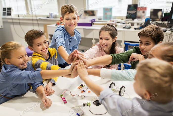 happy children making high five at robotics school