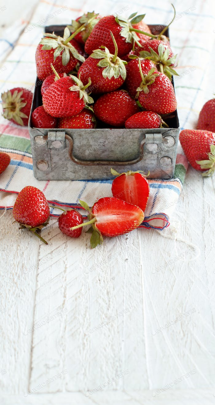Strawberries in a box on a  table