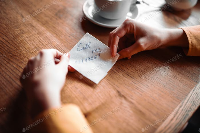 Female person hands holds love note