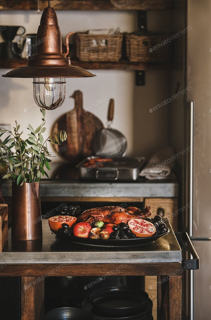 Whole oven roasted duck in seasonal fruits for winter holidays