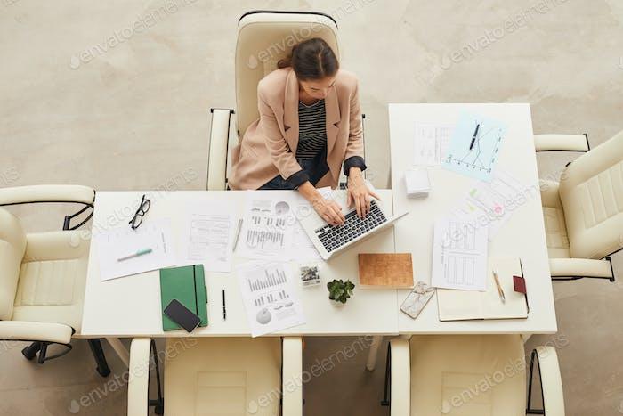 Asian Woman Working Alone