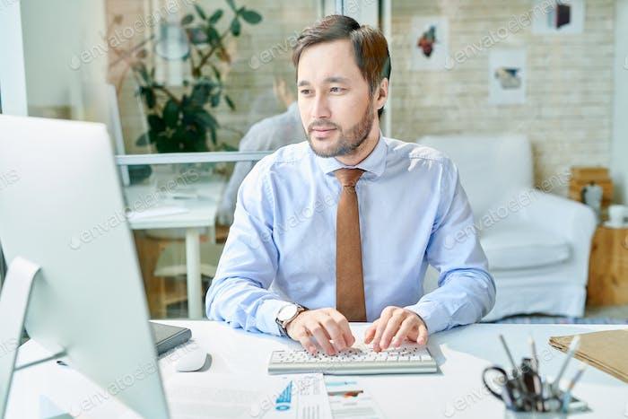 Elegant businessman working on computer