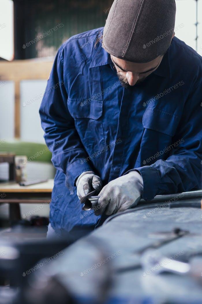 Craftsman working with metal bar