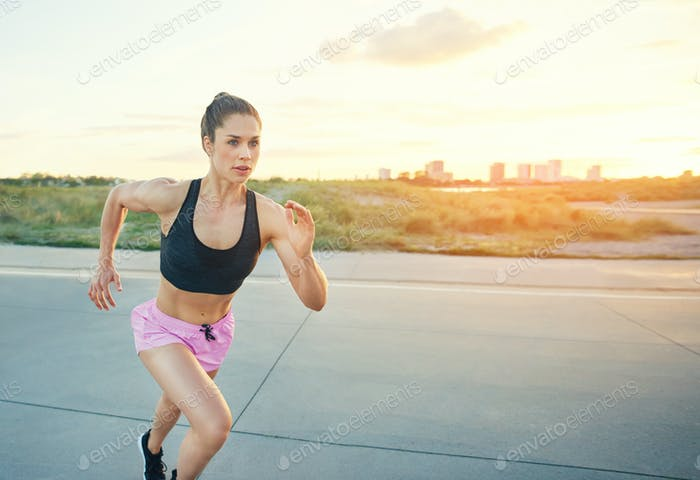 Fit competitive female sprinter working out