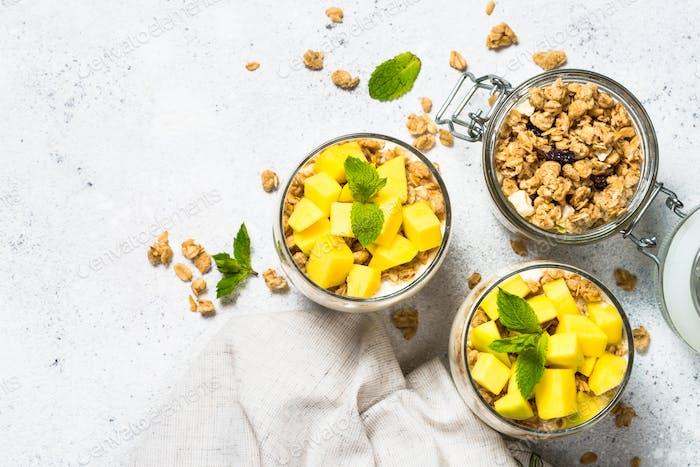 Parfait with yogurt, mango and granola top view