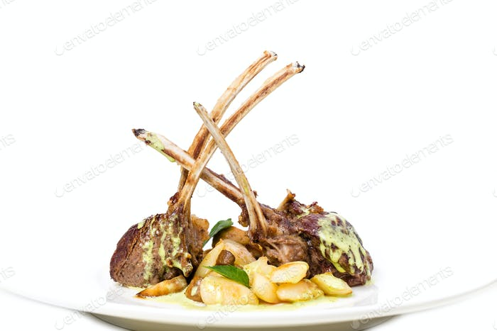Grilled lamb racks with green butter.