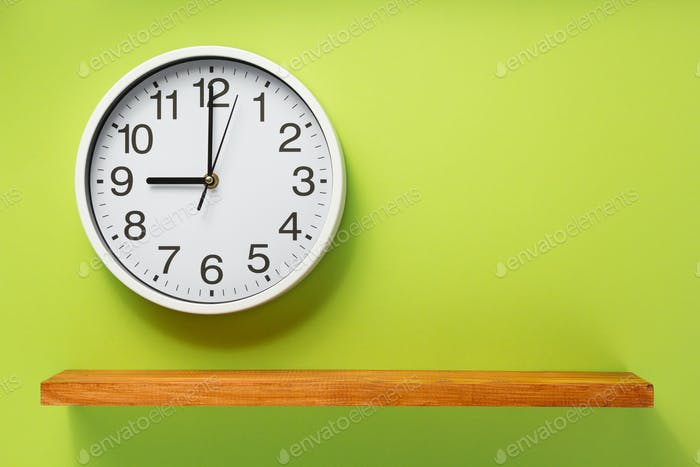 wall clock and shelf at abstract background