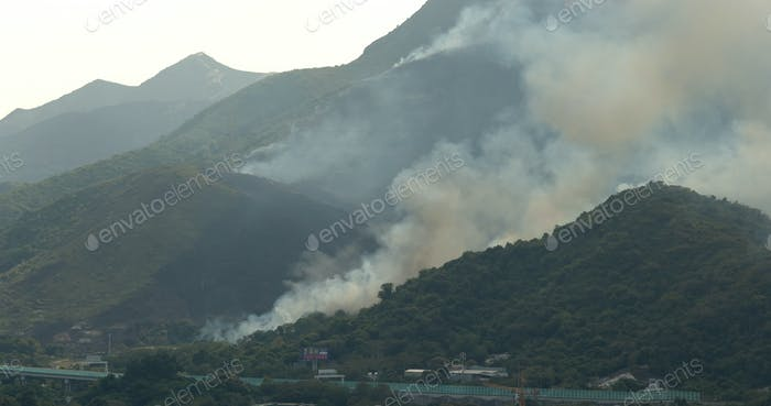 Tin Shui Wai, Hong Kong, 05 April 2018:-Fire accident on mountain with helicopter rescue