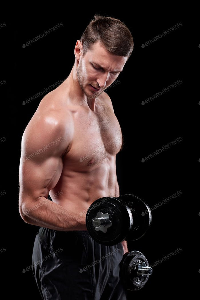 Young muscular shirtless sportsman with dumbbells doing exercise for arms