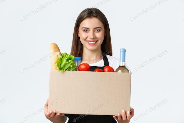 Mitarbeiter, Lieferung und Online-Bestellungen, Lebensmittelgeschäfte Konzept. Freundlich aussehend angenehm jung