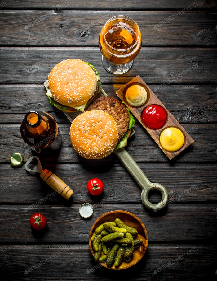 Burgers with beer,gherkins and sauces.