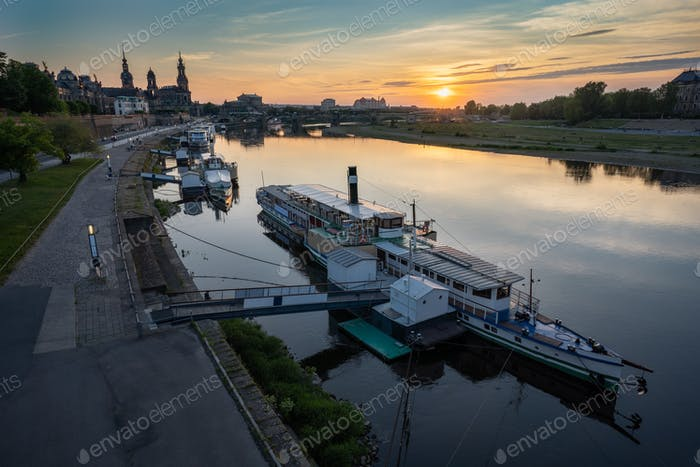 Beautiful Dresden city skyline at Elbe River and tourism pleasure steamship on pier, Dresden, Saxony