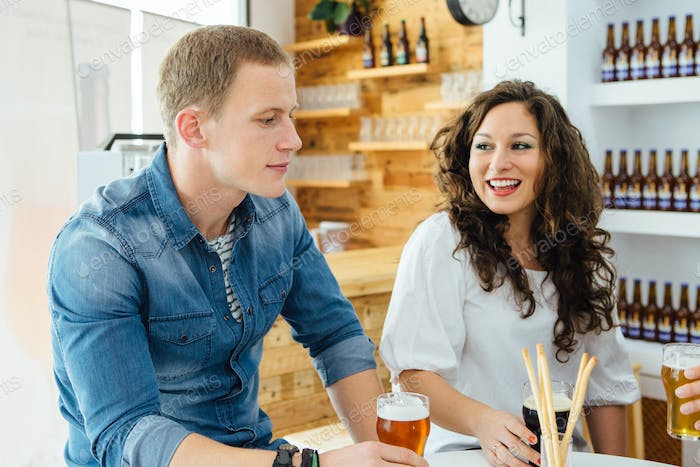 Man and woman tasting craft beer