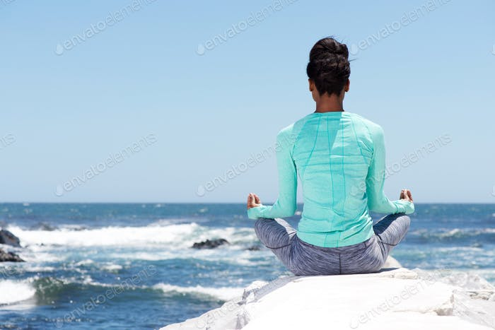 behind of yoga woman at the beach