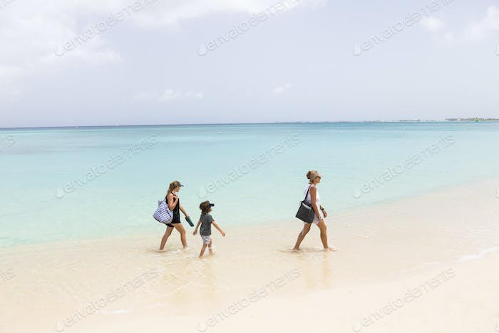 mother and her children walking the beach, Grand Cayman Island