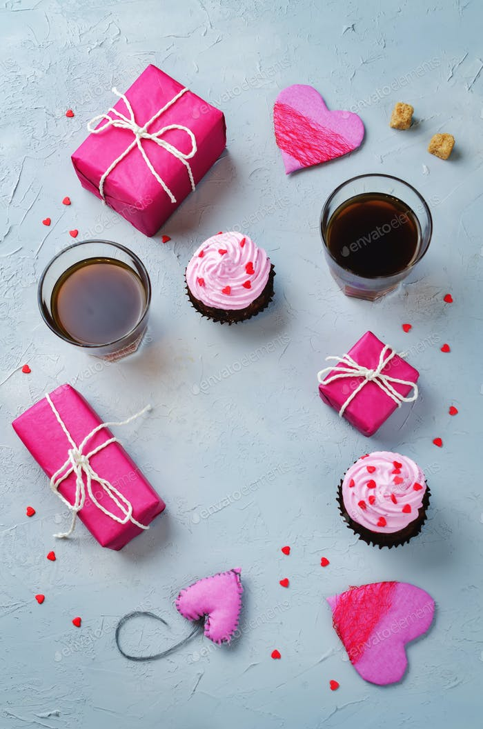 Stone background with gifts, cupcakes, coffee and card
