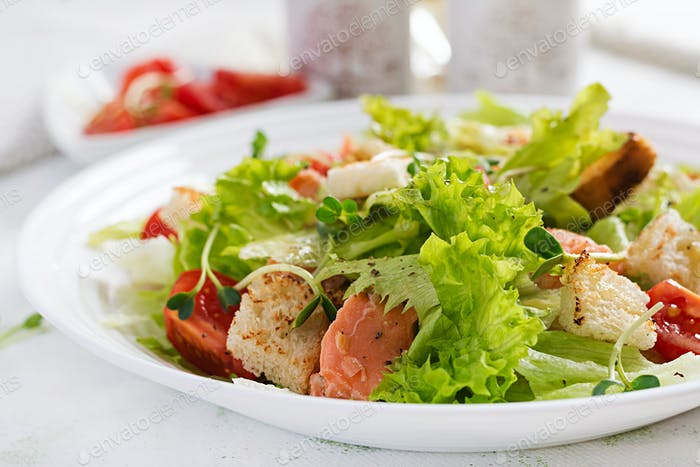 Caesar Salad with Salmon. Fish menu. Seafood - salmon.