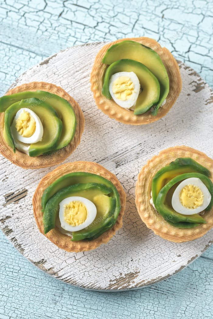 Tartlets with cream cheese, avocado and quail eggs