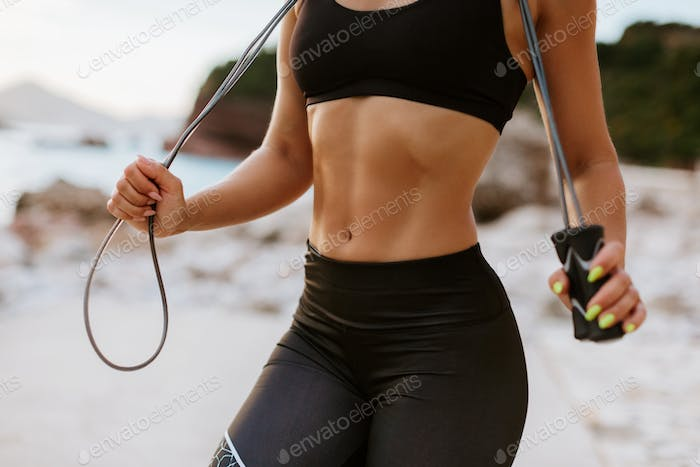 sporty woman abs stomach