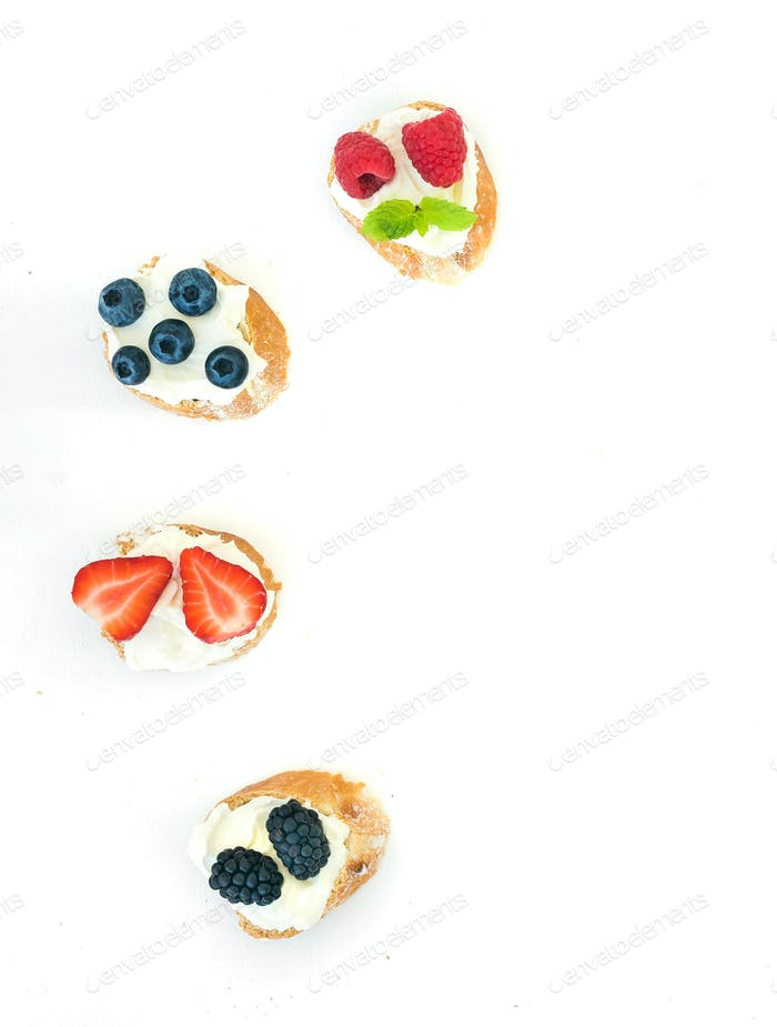 Selection of small sweet sandwiches with cream-cheese and fresh