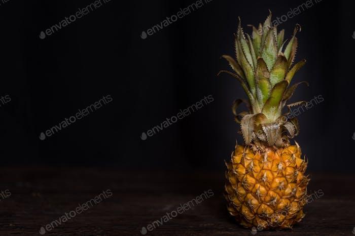 Pineapple on a dark wooden background