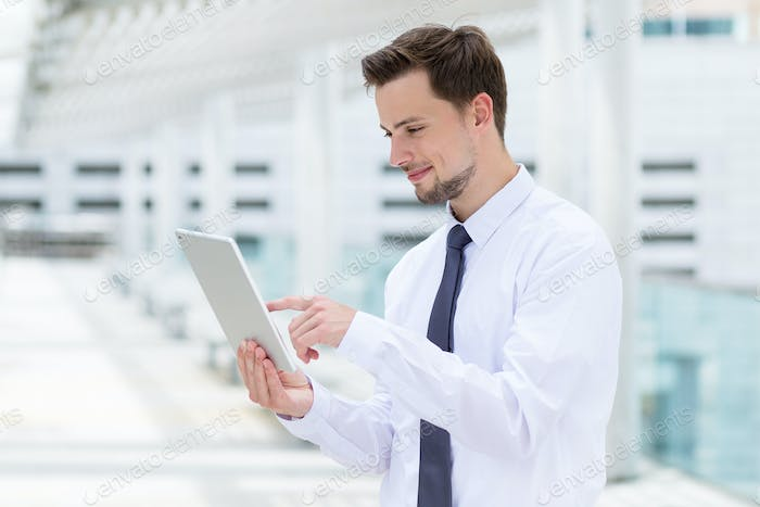 Caucasian businessman touch on digital tablet at outdoor