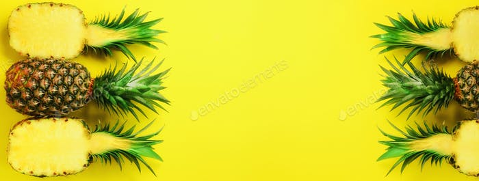 Pattern with bright pineapples on blue background. Top View. Copy Space. Minimal style. Pop art