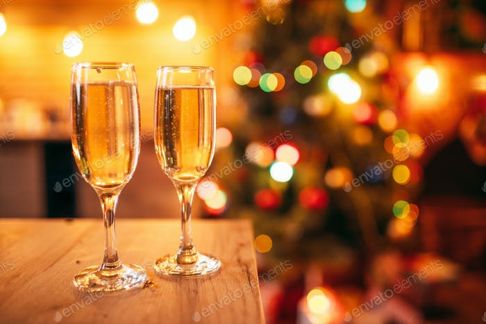 Two glasses with champagne, christmas decoration