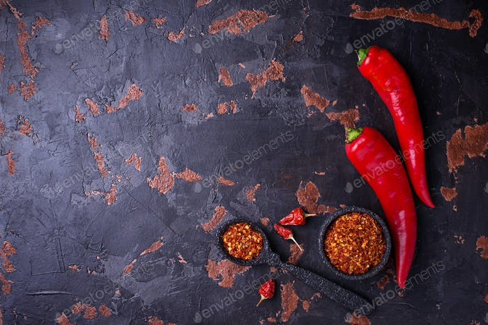Red chili pepper on old rusty background