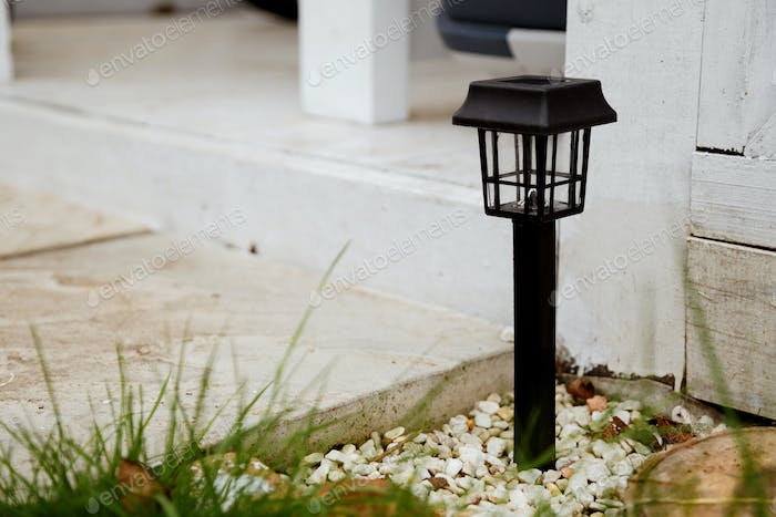 Solar-powered garden lamp in the daytime. Renewable eco energy in domestic life