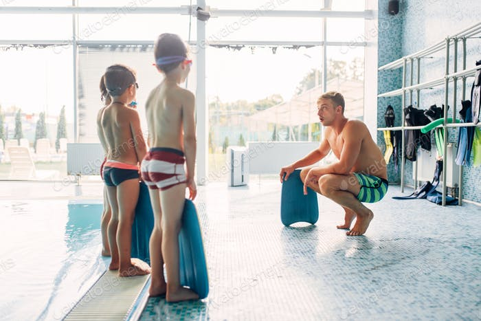 Instructor training children in the pool