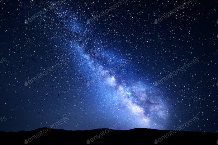 Beautiful blue Milky Way at mountains. Night colorful landscape.