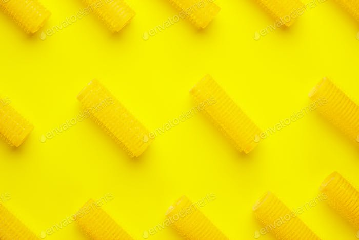 hair curlers on yellow background