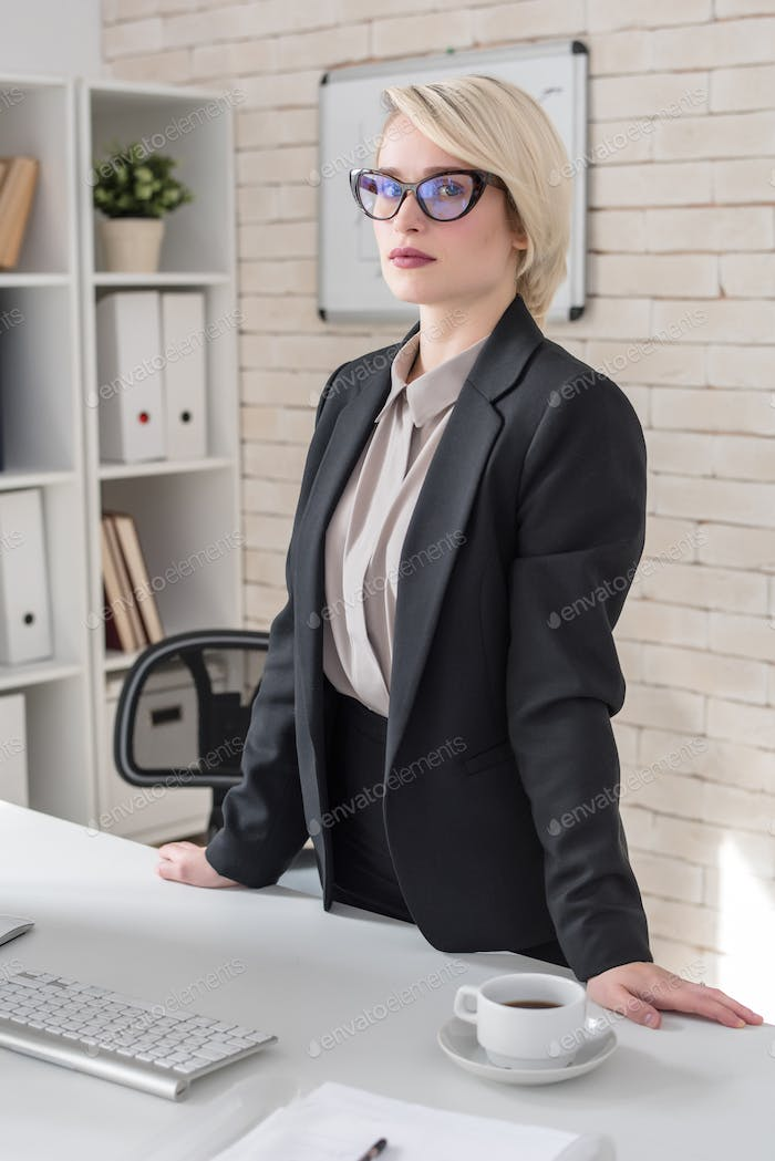 Portrait of Blonde Female Boss in Office