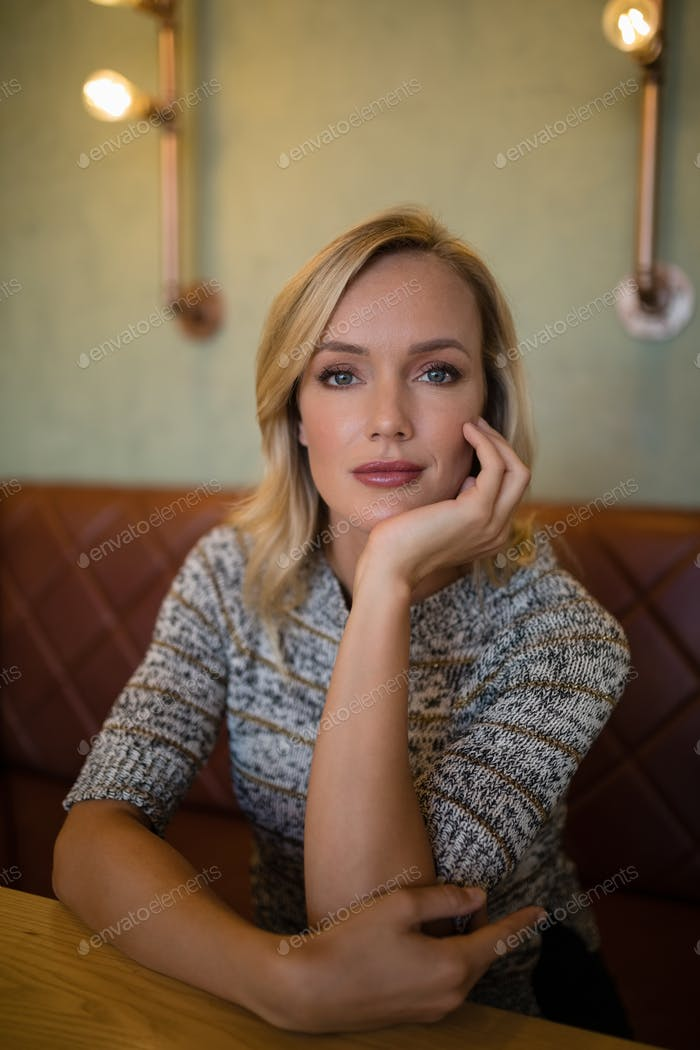 Beautiful woman sitting at table