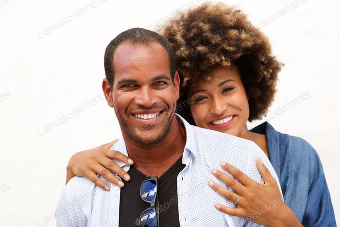 Close up portrait of beautiful couple smiling in embrace