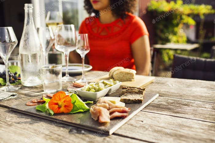 Woman sitting at table with fresh food